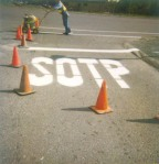 SOTP-huge-white-misspelled-freshly-painted-stop-sign-on-road-ANON