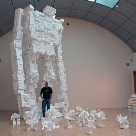 The guy, Michael Salter is a geek who loves styrofoam (or polystyrene foam) sculpture arts so much. He's made many robots out of the styrofoams. And the most amazing is one of the robots is a giant robot that stands at 22-feet tall.
