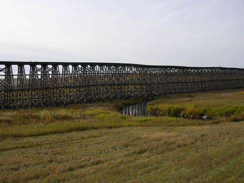 Old abandoned wooden railway trestle near Meskinaw, Saskatchewan, Canada